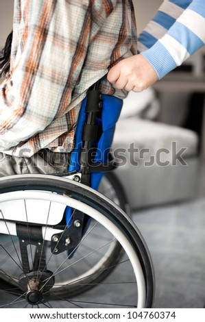 aid for a wheelchair user, care in the family, mobility despite disability - stock photo