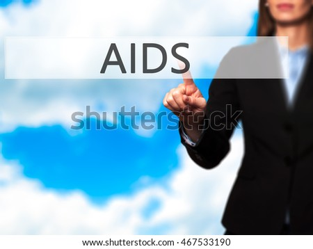 AIDS - Isolated female hand touching or pointing to button. Business and future technology concept. Stock Photo