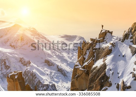 Aiguille du Midi, Mont Blanc, France, Beautiful Sunrise Over Mountain Landscape, Lone Male Mountain Climber  - stock photo