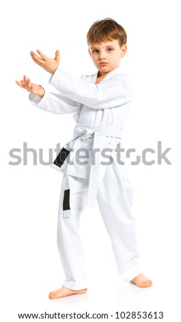 Aikido boy fighting position in white kimono isolated on white