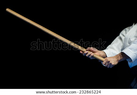 aikido fighter with his wood stick during a public fight demonstration