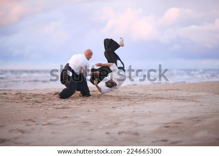 Aikido practitioners on the beach