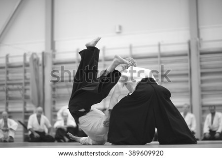 Aikido technique demonstration to students - stock photo