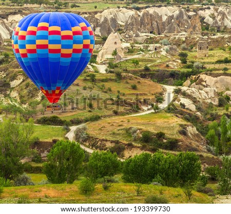 air balloon in mountain scene flying over Cappadocia