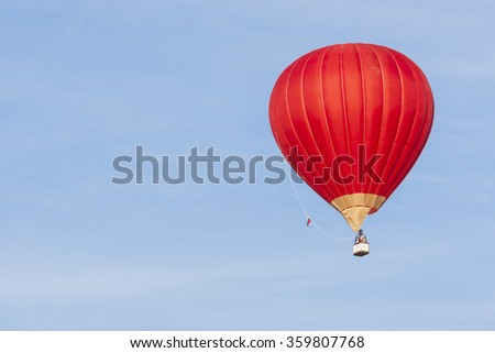 Air Balloon Levitating Over the Crowd of People Standing Outdoors and Watching.Vertical Image Composition - stock photo