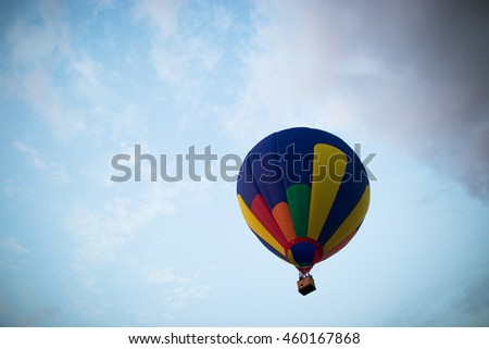 air balloon on a background of sky with white clouds.