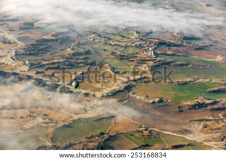 Air Balloon over misty landscape - stock photo