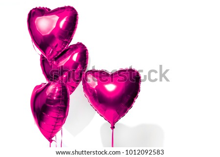 Air Balloons. Bunch of purple heart shaped foil balloons isolated on white background. Love. Holiday celebration. Valentine's Day party decoration. Metallic balloon