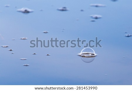 air bubbles on the surface of the water - stock photo