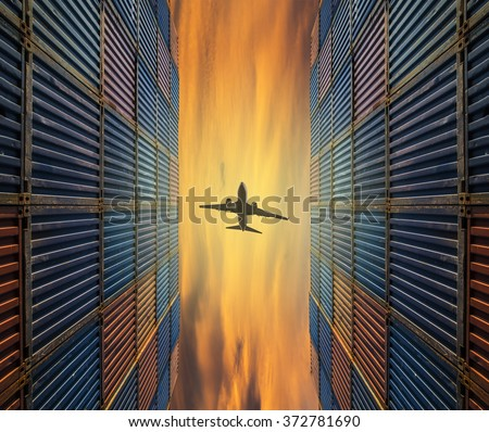 air cargo plane fly over containbox in shipyard with logistic business industry background - stock photo