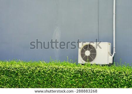 Air compressor installation on pedestal.outdoor - stock photo