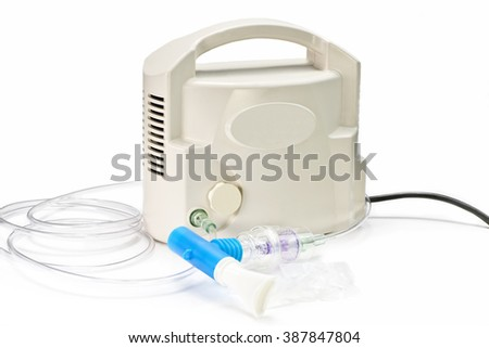 Air compressor medical nebulizer with tubing and mouthpiece. - stock photo