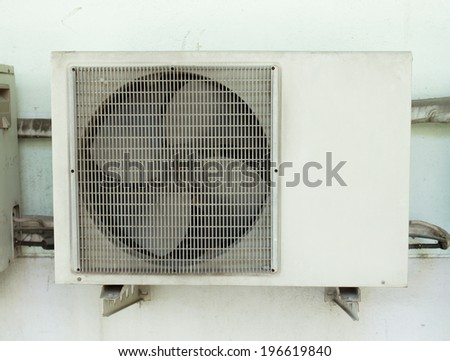 Air compressor on wall - stock photo