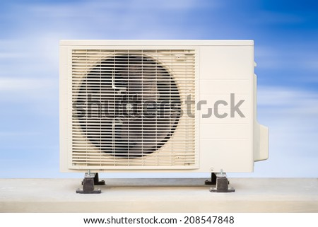 Air compressor with blue sky background. - stock photo