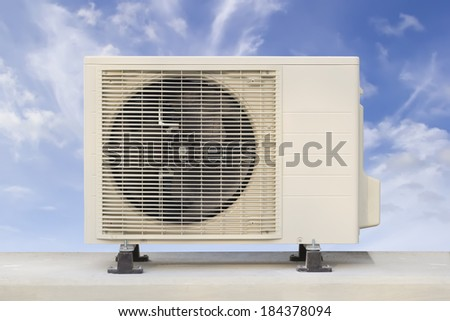 Air compressor with white wall background. - stock photo