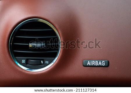 "Air conditioner and The word ""Airbag"" is written on a car's dashboard. - stock photo"