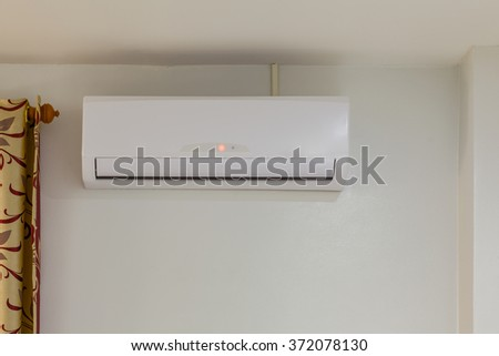 air conditioner install on wall for condo or meeting room, power off - stock photo