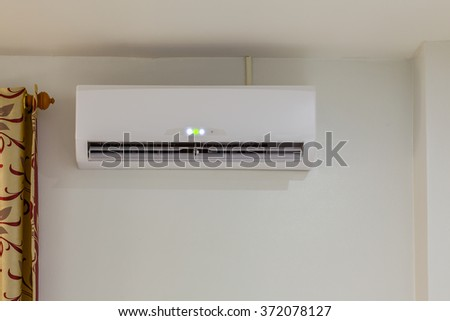 air conditioner install on wall for condo or meeting room, power on