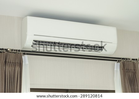air conditioner installed on the wall under the ceiling