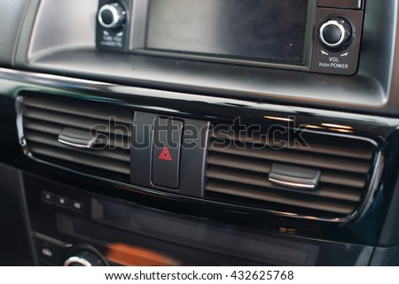 Air conditioner vent grill in a modern car - stock photo