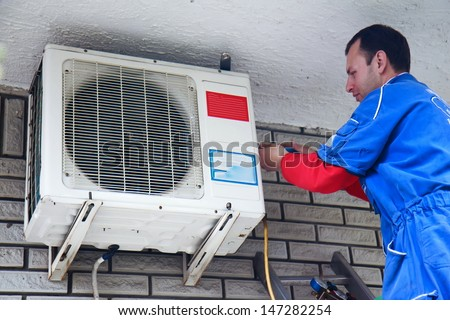Air conditioner worker - stock photo