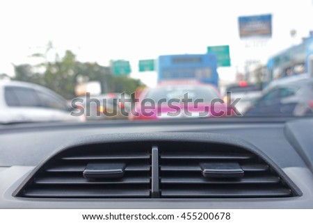 Air conditioning car vent on the blur traffic background.