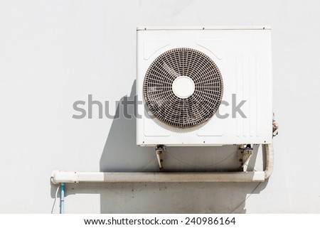 Air conditioning compressor on wall - stock photo