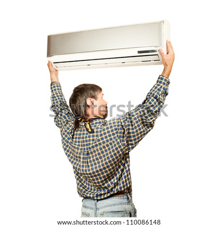 Air conditioning master installing a new air conditioner. Isolated on a white - stock photo