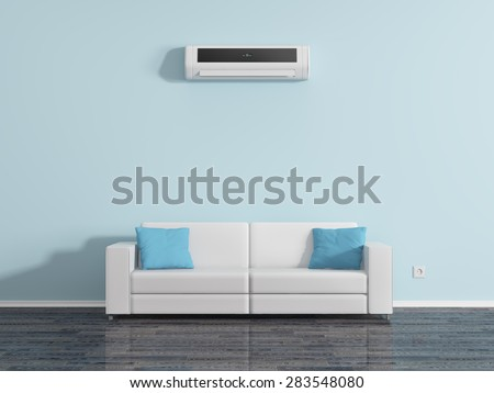Air conditioning on the wall above the sofa cushions. - stock photo