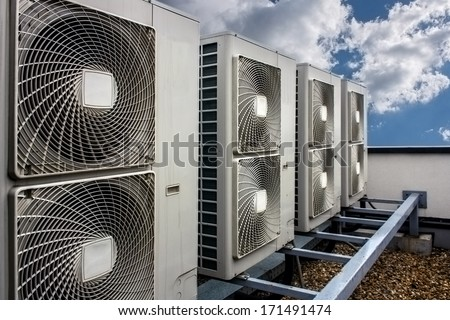 Air conditioning system assembled on side of a building. - stock photo