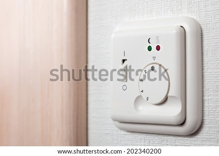 Air conditioning thermostat controller unit. - stock photo