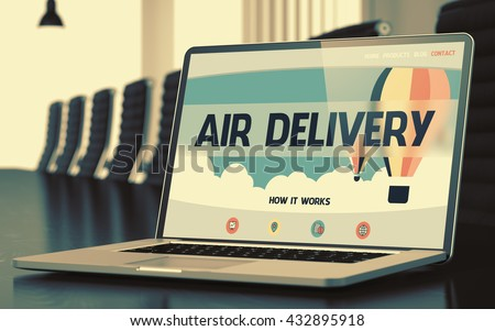 Air Delivery - Landing Page with Inscription on Laptop Display on Background of Comfortable Conference Hall in Modern Office. Closeup View. Toned Image. Selective Focus. 3D Render. - stock photo