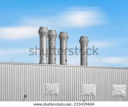 Air duct pipe and roof for industrial with blue sky background..