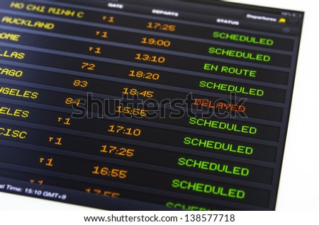Air flight schedule check from tablet computer - stock photo