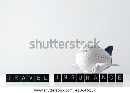 Air flight travel insurance word in front of 3D aeroplane puzzle