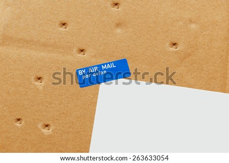 Air Mail, Par Avion envelope parcel detail delivered with damages - seven small perforations on the cardboard - stock photo