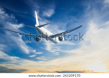 air plane flying on blue sky