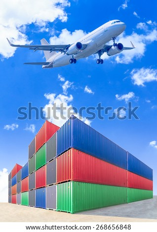 air plane flying over industrial port authority with containers - stock photo