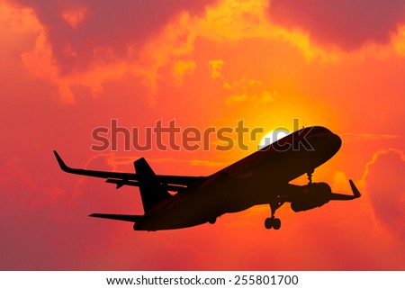 air plane flying with sunset - stock photo
