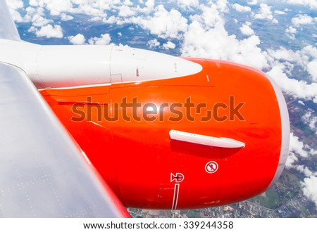 air plane wing with blue sky, wings aircraft with blue sky - stock photo