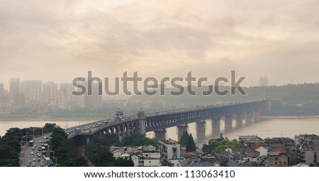 Air Pollution and Traffic on Bridge Number 1, the first bridge over the Yangzi River in Wuhan, Hubei Province, China - stock photo