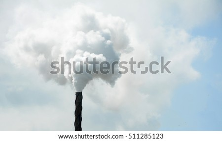 Air pollution by smoke coming out factory chimneys.