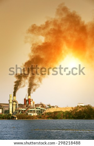 Air pollution by smoke coming out of factory - stock photo