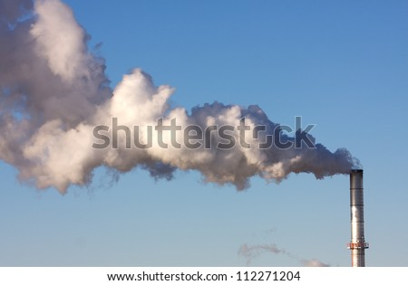 Air Pollution from a smoke stack of a industrial plant - stock photo