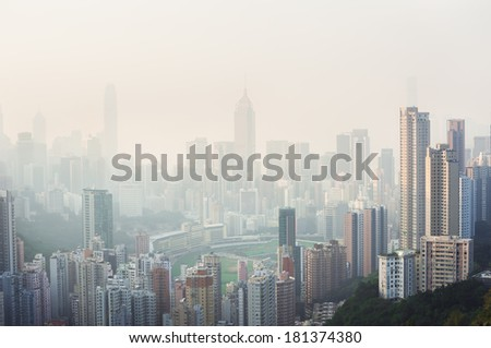 Air pollution hangs over the Happy Valley district of Hong Kong Island - stock photo