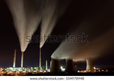 Air pollution of coal power plant at night - stock photo