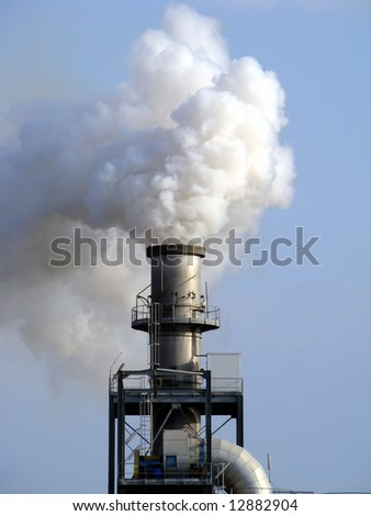 Air Pollution - Smoke from chimney polluting the air