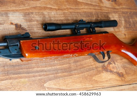 Air rifle isolated on wooden backgound
