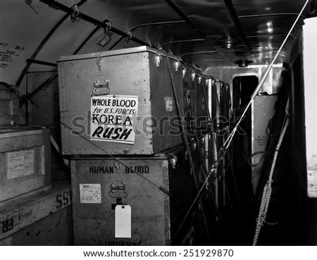 Air shipments of whole blood from American Red Cross for Korean War casualties. It will be stored in Yokohoma, for shipment to Korea as needed. Korean War, 1950-53. - stock photo