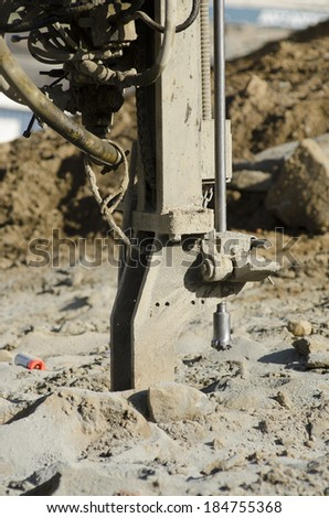 Air Track Rock Drill, Drifter Hammer, Self-contained air compressor  working a new commercial road construction project - stock photo